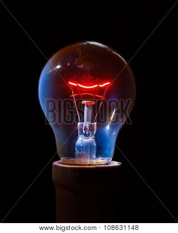 Glowing Light Bulb With Detailed Filament And Inner Glass Body.