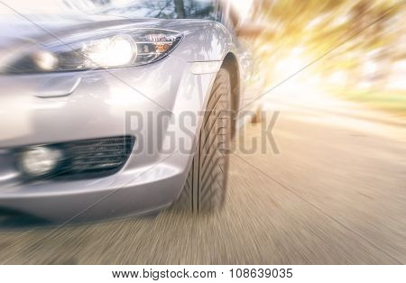 Close Up On A Car Tyre While Drifting On A Street