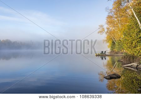 Misty Morning On A Lake In Autumn