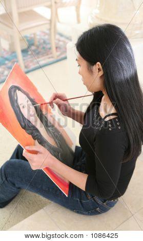 Woman Painting Portrait (Focus On Painter)