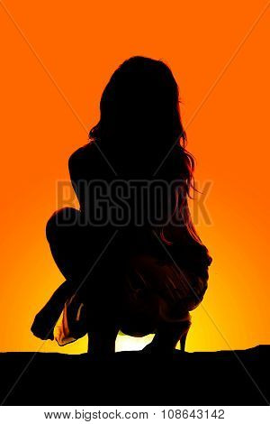 Silhouette Of A Woman Sit Down