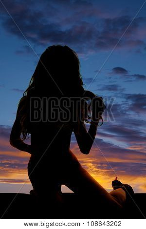 Silhouette Of Woman In Bikini Kneel Play With Hair
