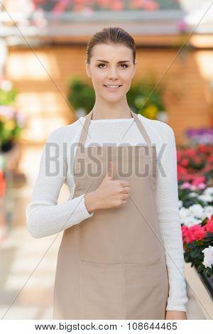 Positive flower seller at work