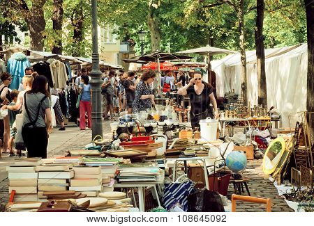 Housewifes Choose Plates And Household Utensils On Flea Market