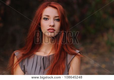 Outdoors Portrait Of Beautiful Young Woman With Red Hair