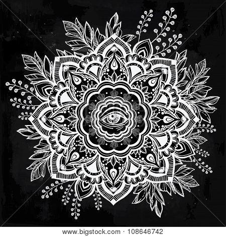 Hand drawn ornate flower with eye inside.