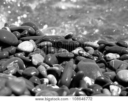 Stones On Background Of Sea Water With Reflections Black And White