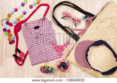 Summer Blouse And Accessories Arranged On The Floor.