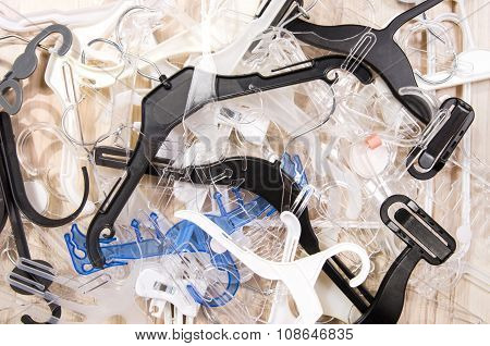 Big Messy Pile Of Hangers On The Floor.