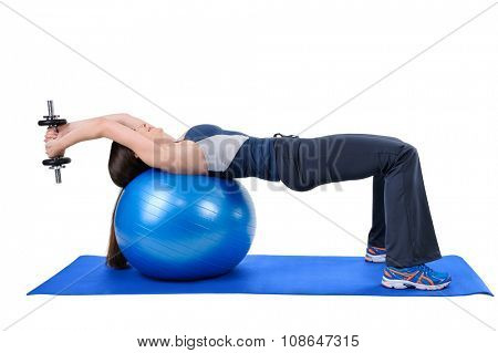 Young woman shows starting position of Fitness Ball Dumbbell Pullover Workout, isolated on white