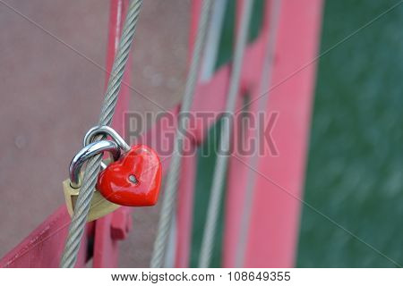 Red heart shaped locket and padlock