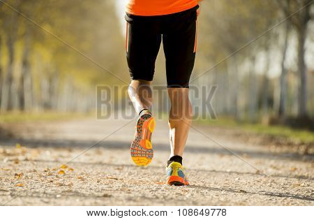 Sport Man With Strong Calves Muscle Running Outdoors In Off Road Trail Ground With Trees Under Beaut