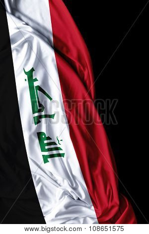 Iraq waving flag on black background