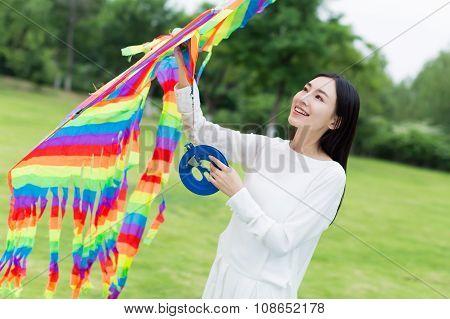 Girl Holding A Kite