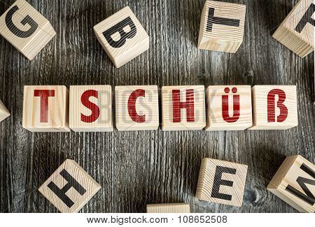 Wooden Blocks with the text: Bye (in German)