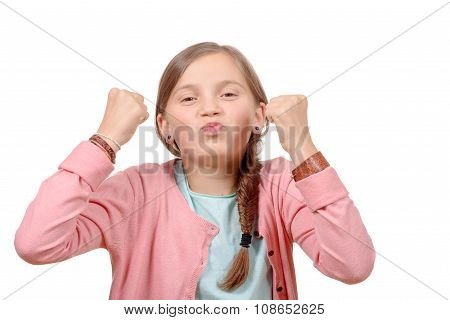 Cute Little Years Girl Raises Her Hands In A Victory Sign On White Background