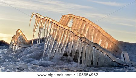Abstract Frozen Thawing Icicles With Sun In Background, Caramel Color