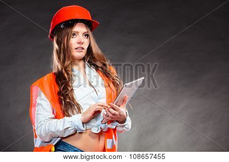 Woman Structural Engineer With Tablet Working.