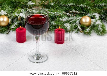 Red Wine With Christmas Objects Covered With Fresh Snow