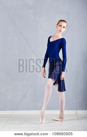 Slim Ballerina In A Blue Dress Dancing.