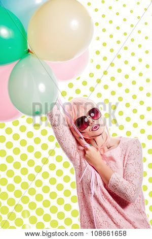 Girl With Makeup In The Style Of Pop Art And Balloons. Colored Background.