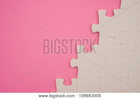 Jigsaw Puzzle On A Pink Background With Copy Space