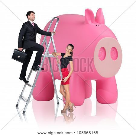 Business people near big piggy bank