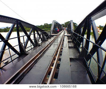 Kanchanaburi,thailand-august 28 : People Taking Photo With The Running Train On The Bridge
