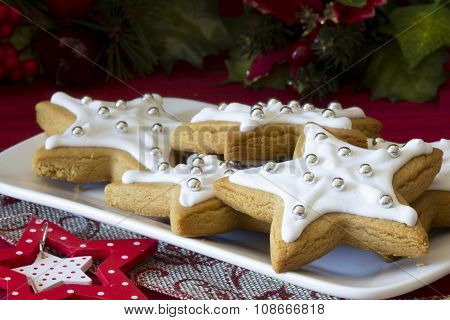 Decorated Christmas Star Cookies on a Plate