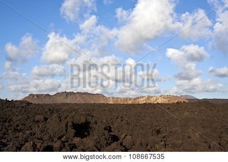 vulcanic landscape under the extincted vulcano with blue sky