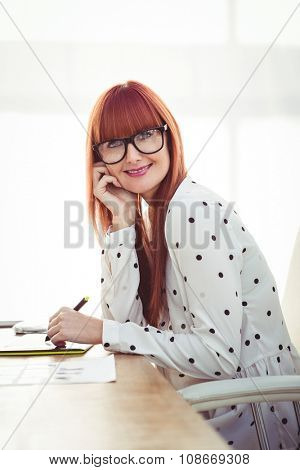 Attractive hipster woman using graphics tablet in her office