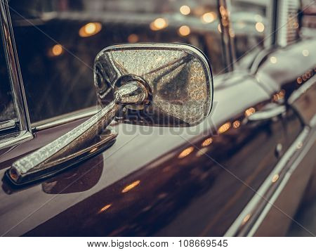 Close-up Mirror Sideview Of Classic Car, Have More Dirty Dust And Rust.