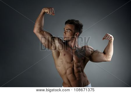 Narcissistic tanned guy posing with naked torso