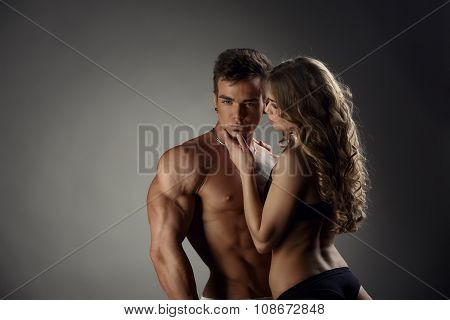 Girl admires hot guy and he posing at camera