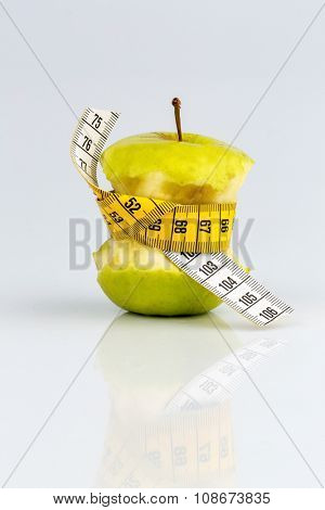 apple with a tape measure. symbolic photo for diet and healthy, vitamin-rich diet.