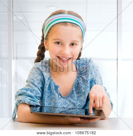 Cute little girl and her tablet