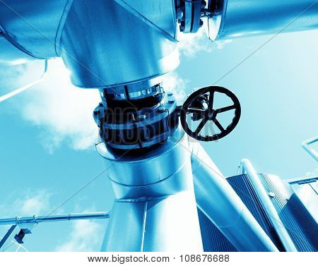 Industrial Zone, Steel Pipelines And Valves In Blue Tones