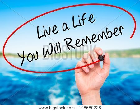 Man Hand writing Live a Life You Will Remember with black marker on visual screen.