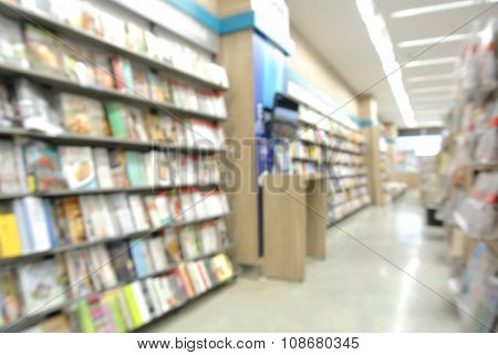 Stack Of Book And Bookshelf In Book Store (blur Background)