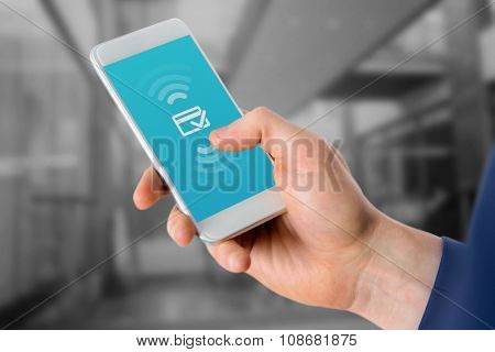 Businessman using mobile phone over white background against wifi connection