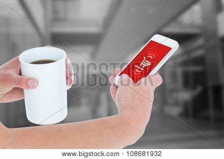 Woman using smartphone while holding coffee against payment screen