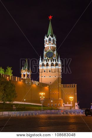 Night view of Spasskaya Tower of the Moscow Kremlin and wall of the Kremlin with illumination and streetlights
