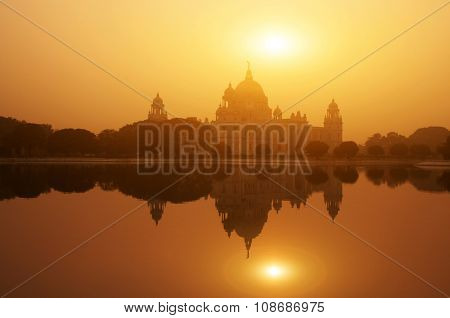 Sunset lake reflection Victoria Memorial in Kolkata or Calcutta, India.