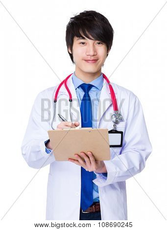 Male doctor take note on clipboard