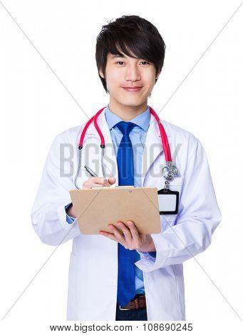 Male doctor take note on clipboard