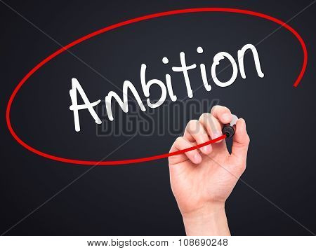 Man Hand writing Ambition with black marker on visual screen.