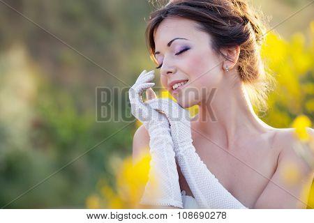 Bride outdoor portrait in flowers