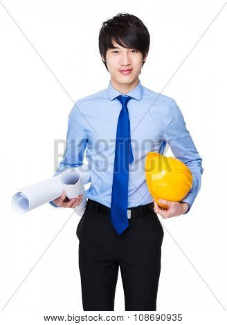 Asian engineer hold with layout drawing and yellow hardhat