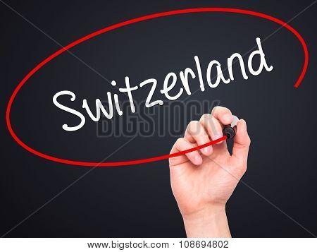 Man Hand writing Switzerland with black marker on visual screen.