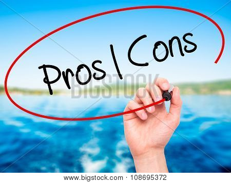 Man Hand writing Pros Cons with black marker on visual screen.